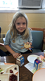 Young girl holding homemade cookie