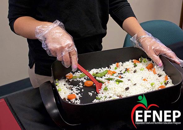 Woman cooking veggie rice
