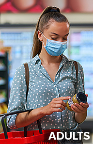 Woman wearing face mask grocery shopping