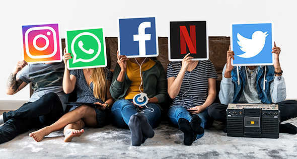 People Sitting with Social Media Signs