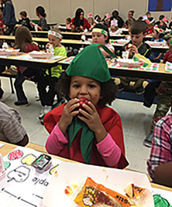 Child biting apple