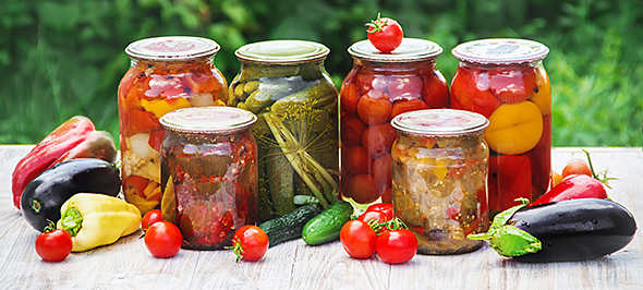Variety of fresh vegetables in jars