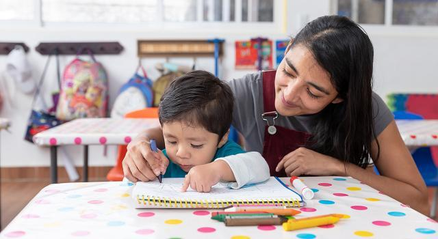 Young Mexican woman teaches toddler